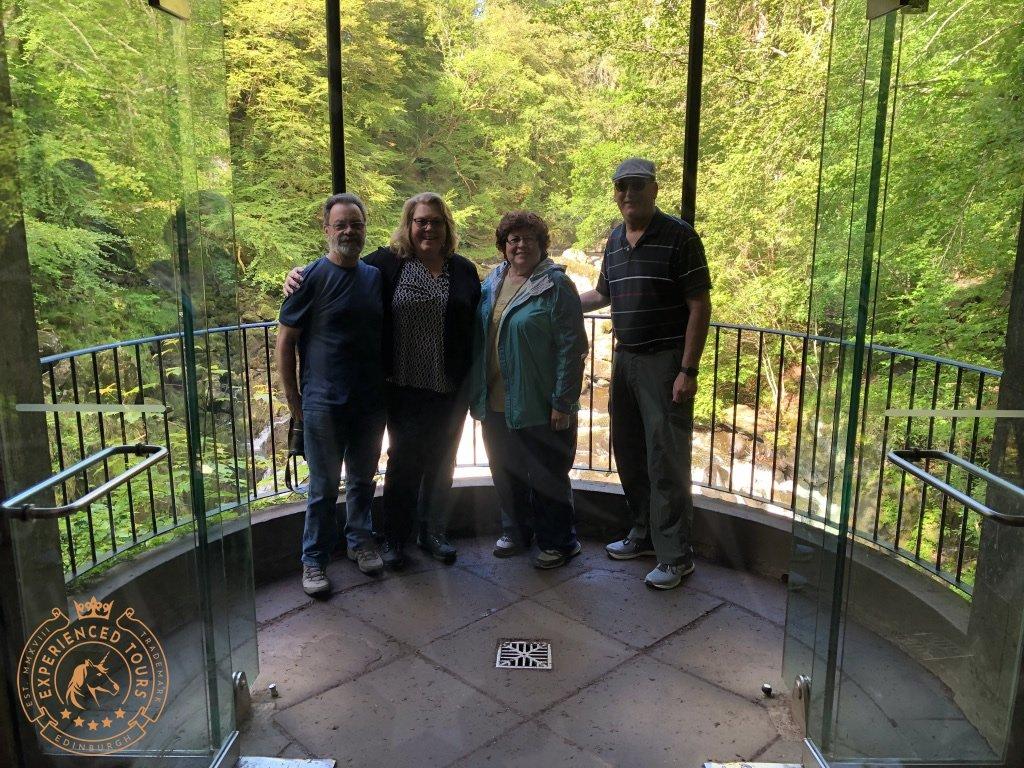 Tour group inside Ossian's Hall