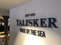 Entrance sign to Talisker Distillery on Skye