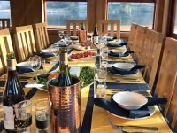 Dinner is served on Glen Massan Cruise ship of The Majestic Line