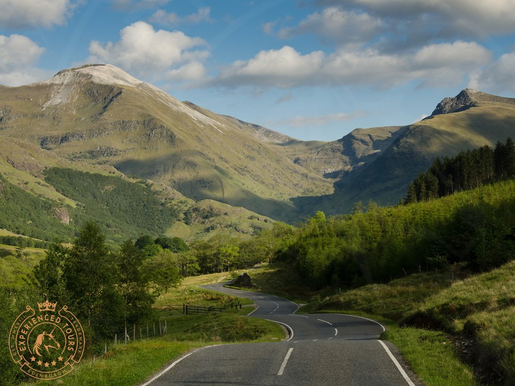 Road winding through the Scottish Highlands